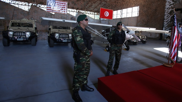 Tunisian soldiers stand in front of military equipment offered to Tunisia by the United States, in Tunis